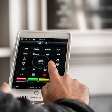 This image shows someone using an app on their ipad to control their home theatre system.